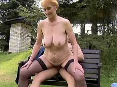 Hot busty granny rides cock in park