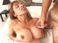 Mature gets cum on massive melons